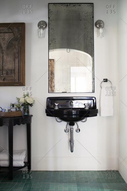 Repurposed furnishings in a bathroom interior