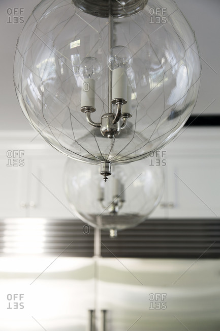 Glass globe light fixtures in a kitchen