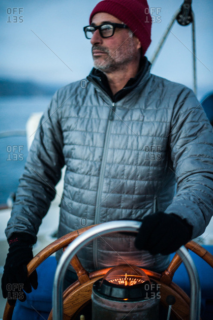 Portrait of man steering a sailboat