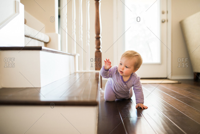 Baby crawling towards a staircase
