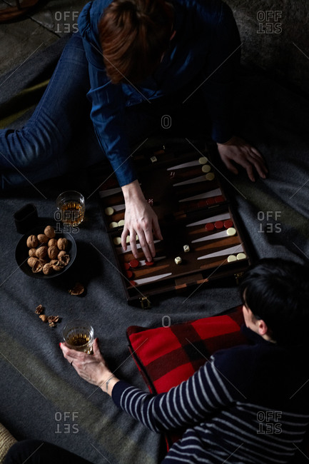 Two women playing a game of backgammon