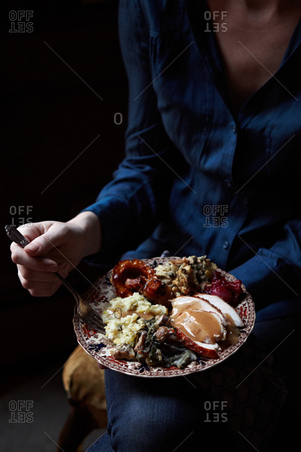 Woman eating turkey, mashed potatoes and stuffing
