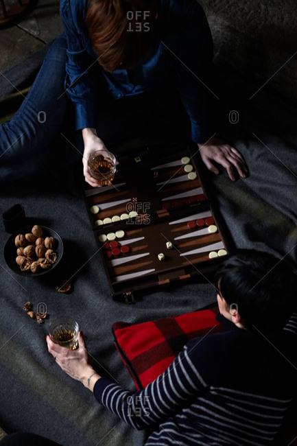 Two women enjoying a game of backgammon