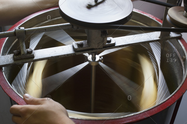 High angle view of honey being separated in machinery at industry