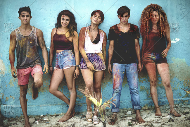Group of teens covered in colored powder