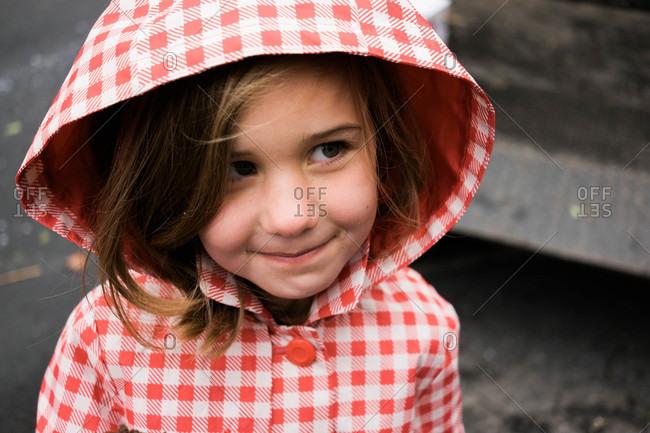 Portrait of girl with hooded rain coat