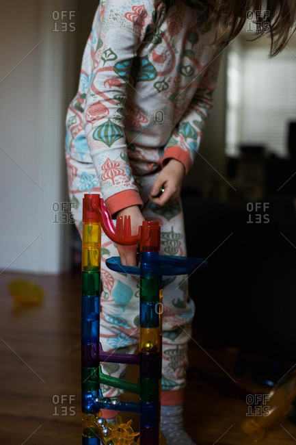 Girl with stackable chute toy