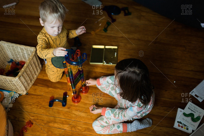 Boy and girl playing with chute toy