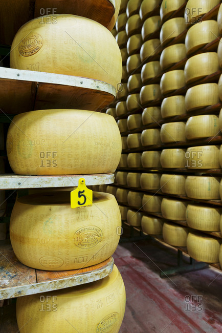Modena, Italy - October 23, 2013: Wheels of parmesan aging on shelves