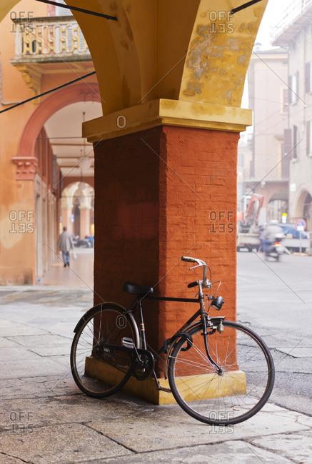 Bike under colonnade in Modena, Italy