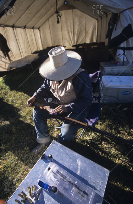 Cowboy cleaning his rifle in Idaho's Smoky Mountains