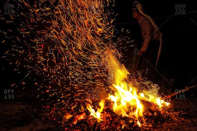 Yingpanxu, China - July 24, 2013: Man by funeral pyre in rural China