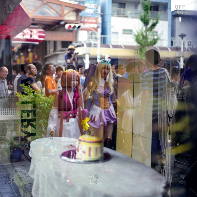Nagoya, Japan - 2014: Reflected cosplay participants
