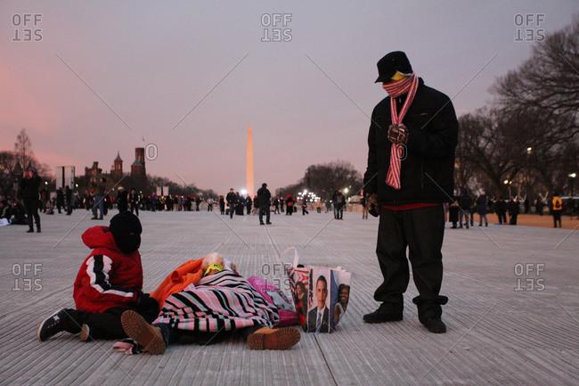 Washington D.C., USA - January 21, 2013: Spectators at the second inauguration of Barack Obama in front of the Washington Monument