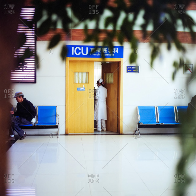 Lijiang, China - April 10, 2014: Nurse entering the ICU of Chinese hospital