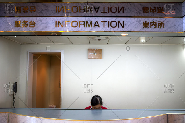 Employee at information desk on Asian ferry