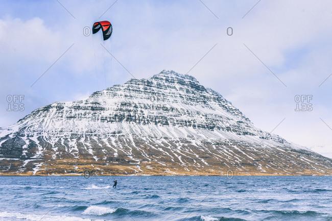 Kite surfing by Eskifjordur, Iceland