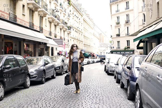 Stylish woman walking in Parisian street