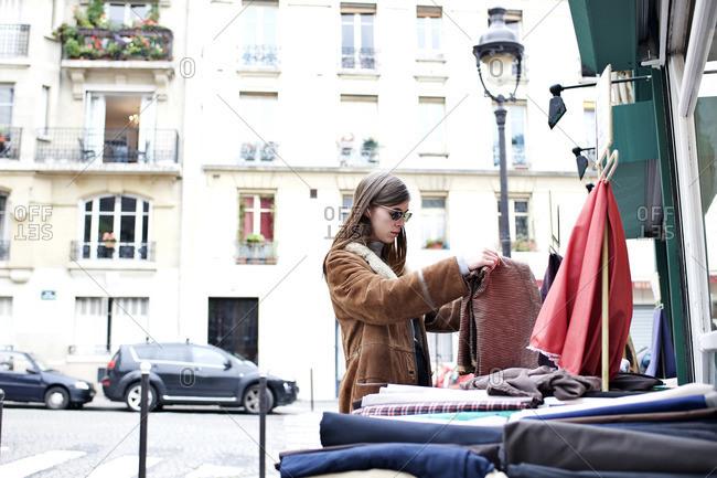 Stylish woman browsing in Parisian street