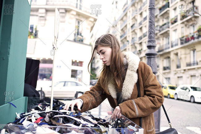 Stylish woman shopping in Parisian street