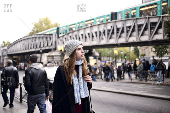 Woman in cool weather clothes walking in Paris