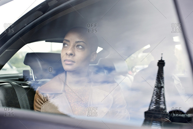 Woman riding in Parisian cab