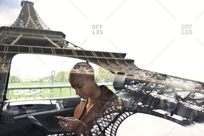 Eiffel Tower reflected in woman's cab window