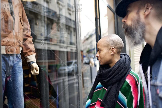 Multi-ethnic couple window shopping