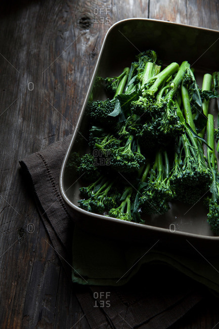 Fresh broccolini in a metal roasting pan