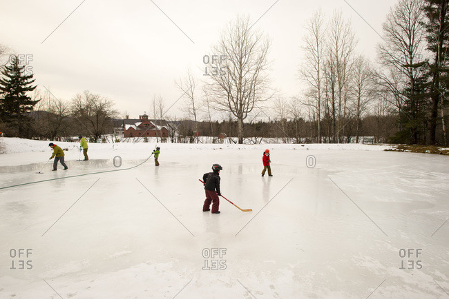 Children playing on an outdoor ice rink