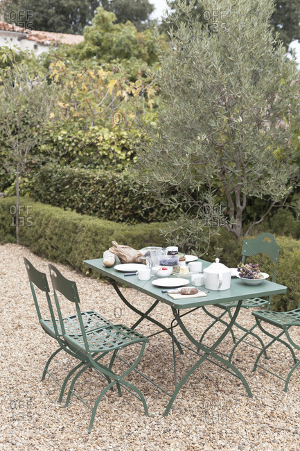 Patio table with breakfast in southern France
