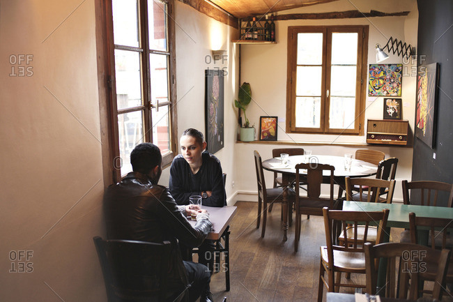 View inside a restaurant with a couple sitting at a table