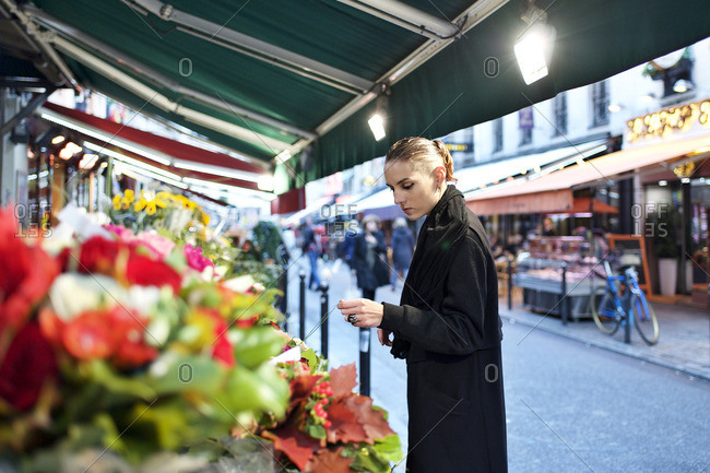 Woman looking at bouquets of flowers