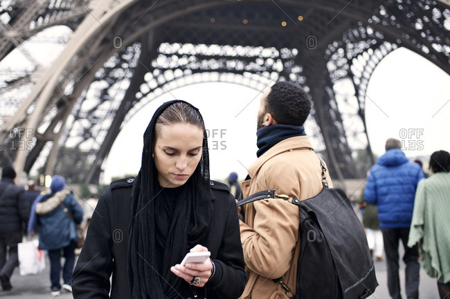 Couple visiting the Eiffel Tower, Paris, France