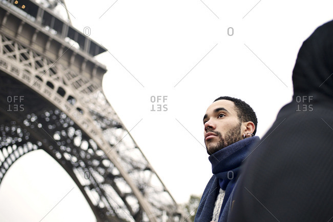 Man visiting the Eiffel Tower, Paris, France
