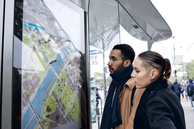 Couple looking for directions on street map