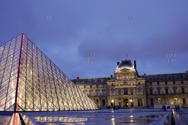 Paris, France - October 16, 2015: Purple sky over the Louvre Museum at night, Paris, France