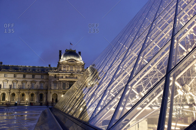 Paris, France - October 16, 2015: Close up of pyramid in front of the Louvre Museum at night, Paris, France