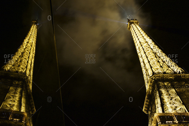 Paris, France - October 16, 2015: Double view reflection of the Eiffel Tower illuminated at night, Paris, France