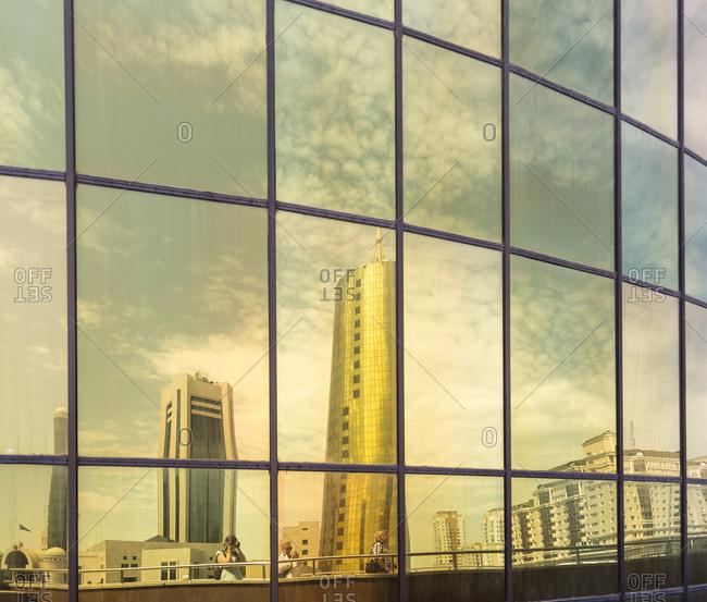 Astana, Kazakhstan - July 18, 2015: Skyline reflected in the window of a modern building