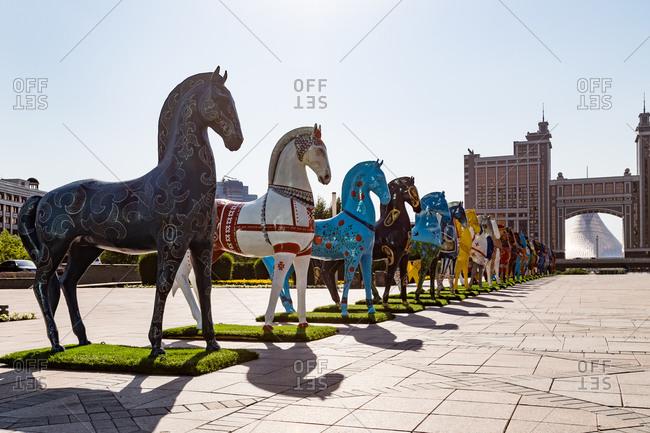 Astana, Kazakhstan - July 18, 2015: Horse statues in a plaza in Astana, Kazakhstan