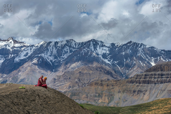 Spiti Valley, India - July 23, 2015: Monks on Himalayan mountain overlook