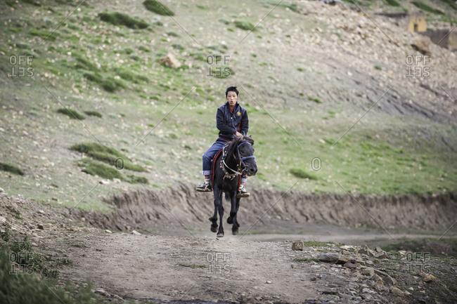 Man on horseback in remote Himalayas