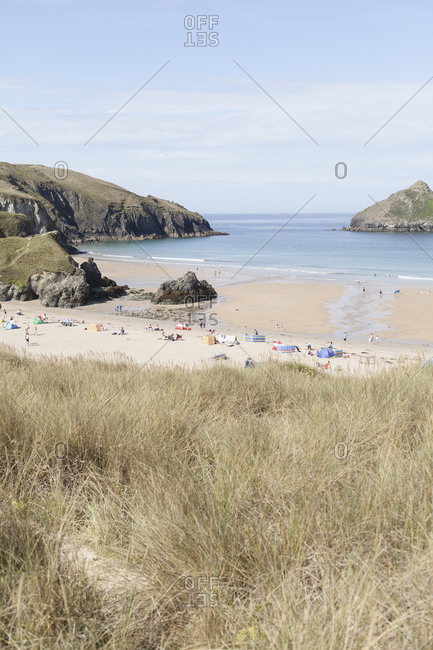 Beachgoers on beach in Cornwall, England