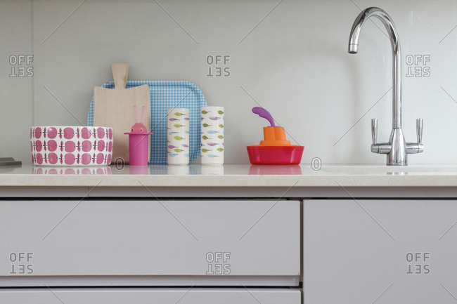 Patterned kitchenware on counter next to sink