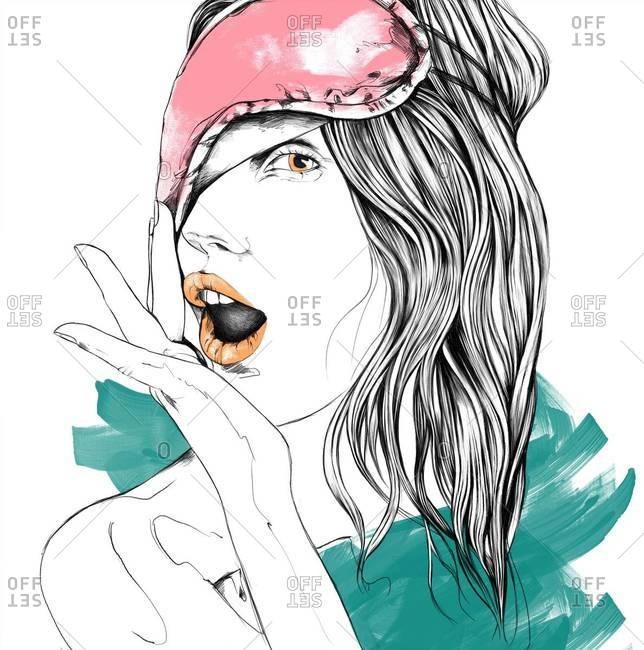Woman wearing an eye mask yawning