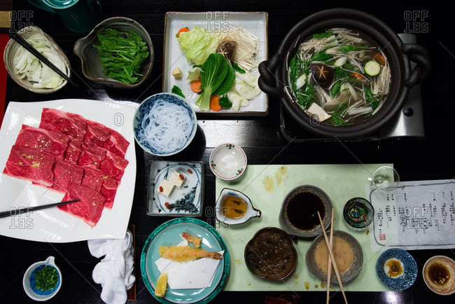 Overhead view of table set for a hot pot meal in Japan