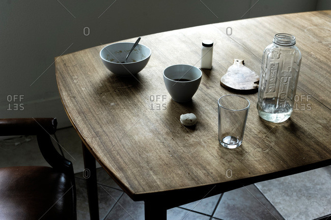 Empty bowls and cups on a wooden table