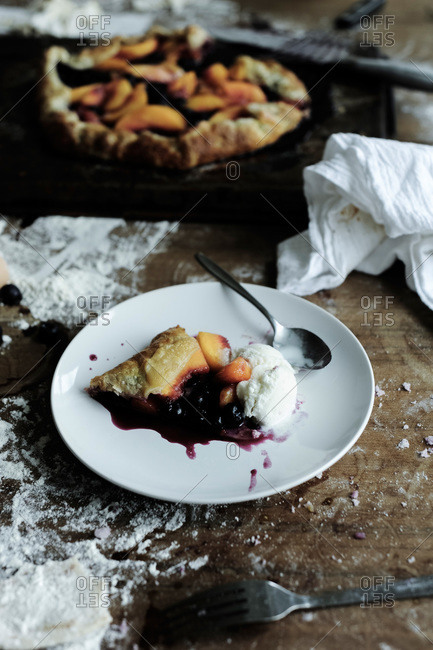 Fruit and berry galette with ice cream