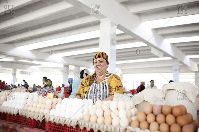 Samarkand, Uzbekistan - June 28, 2015: Egg seller in the traditional market
